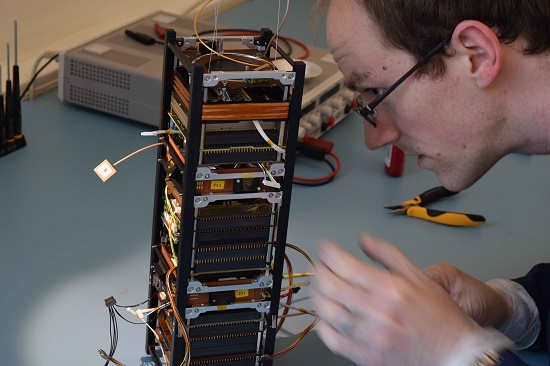 The technology-testing GomX-3 under construction. A 'three-unit' CubeSat, it measures 10x10x30 cm in size with an approximate mass of 3 kg, with payloads to detect signals from aircraft and telecom satellites. (Credit: davidgerhardt.com)
