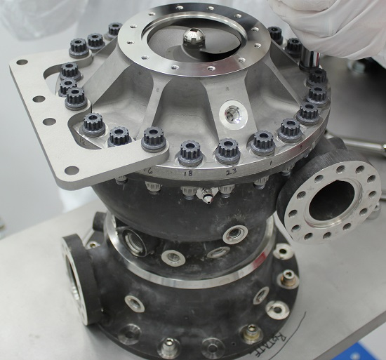 This rocket engine fuel pump has hundreds of parts including a turbine that spins at over 90,000 rpms. This turbopump was made with additive manufacturing and had 45 percent fewer parts than pumps made with traditional manufacturing. It completed testing under flight-like conditions at NASA's Marshall Space Flight Center in Huntsville, Alabama. (Credits: NASA/MSFC)