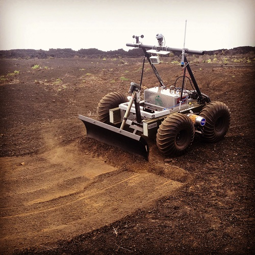 The Helelani Rover during initial integration tests with one of the end effectors to be used in the site preparation phase of the lunar landing pad project. (Credit: PISCES)
