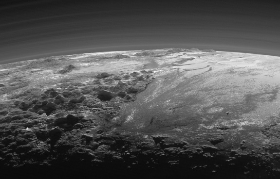 Closer Look: Majestic Mountains and Frozen Plains: Just 15 minutes after its closest approach to Pluto on July 14, 2015, NASA's New Horizons spacecraft looked back toward the sun and captured this near-sunset view of the rugged, icy mountains and flat ice plains extending to Pluto's horizon. The smooth expanse of the informally named Sputnik Planum (right) is flanked to the west (left) by rugged mountains up to 11,000 feet (3,500 meters) high, including the informally named Norgay Montes in the foreground and Hillary Montes on the skyline. The backlighting highlights more than a dozen layers of haze in Pluto's tenuous but distended atmosphere. The image was taken from a distance of 11,000 miles (18,000 kilometers) to Pluto; the scene is 230 miles (380 kilometers) across. (Credits: NASA/JHUAPL/SwRI)