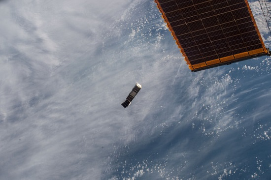 ESA's GomX-3 CubeSat plus the smaller student-built AAUSat-5 after being deployed from the NanoRacks dispenser on Japan's Kibo module of the International Space Station on 5 October 2015. They entered space together but a spring system pushed them away from each other. By the end of the week they were orbiting upwards of 100 km apart. (Credit: ESA/NASA)