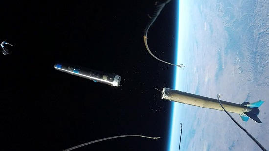 Nose fairing camera. view of an UP Aerospace booster separating in space and ejecting the Maraia capsule. (Credit: UP Aerospace)