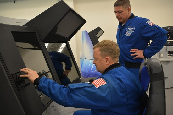 Astronauts Eric Boe and Bob Behken at CST-100 Starliner trainer. (Credit: Boeing)