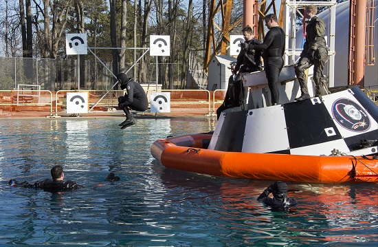 Astronaut Suni Williams jumps into the Hydro Impact Basin at NASA's Langley Research Center after completing a practice session with an Air Force pararescue team with a mock-up of a Boeing CST-100 Starliner. (Credit: NASA/ Langley Research Center)
