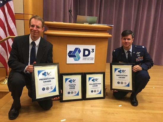 Paul Jaffe and Peter Garretson with awards. (Credit; NSS)