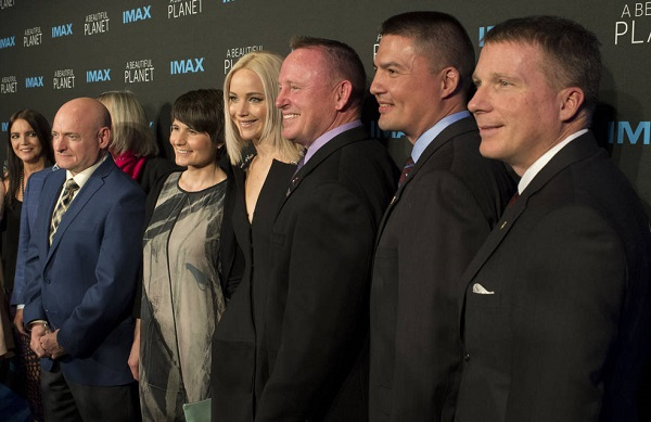 "Former NASA astronaut Scott Kelly, left, ESA astronaut Samantha Cristoforetti, second from left, Jennifer Lawrence, third from left, NASA astronaut Barry Wilmore, third from right, NASA astronaut Kjell Lindgren, second from right, and NASA astronaut Terry Virts, right, post for a picture as they arrive for the world Premiere of the IMAX film ""A Beautiful Planet"" at AMC Lowes Lincoln Square theater on Saturday, April 16, 2016 in New York City. The film features footage of Earth captured by astronauts aboard the International Space Station. (Credit: NASA/Joel Kowsky)"
