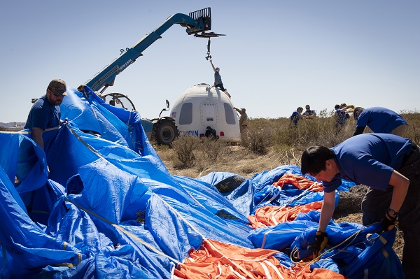 Members of the Blue Origin team recover the Crew Capsule after its fifth successful flight and soft landing. (Credit: Blue Origin)