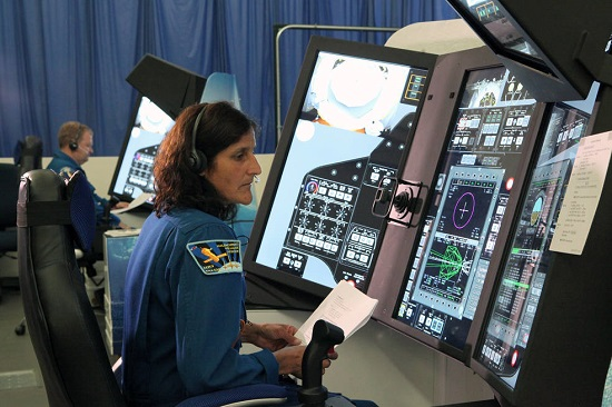 Astronauts Suni WIlliams and Eric Boe evaluate part-task trainers for Boeing's CST-100 Starliner at the company's St. Louis facility. (Credit: NASA/Dmitri Gerondidakis)