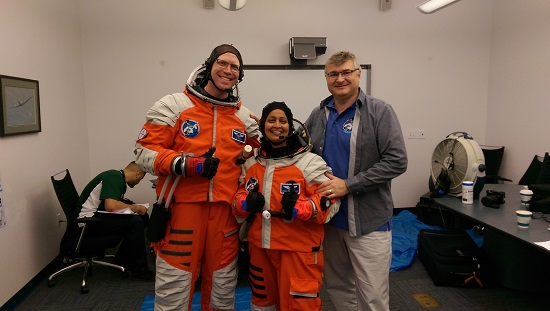 FFD co-founded Nikolay Moiseev testing the fit range of FFD's 3G Suit (large) vs. Terra-Suit (med) with Project PoSSUM participants Tom Foltz (L) and Anima Patil-Sabale (R). (Credit: Final Frontier Design)