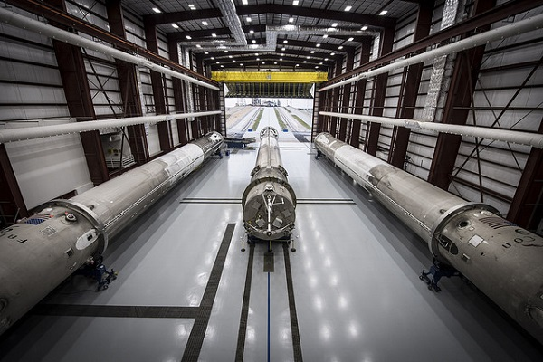 Three recovered Falcon 9 first stages in Hangar 39A at NASA's Kennedy Space Center. (Credit: SpaceX)