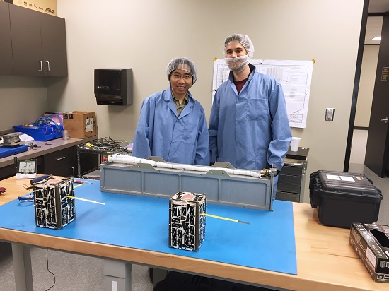 Members of the NASA Ames Nodes Integration & Test team ready to integrate the Nodes 1 and 2 spacecraft (forefront) into the Nanoracks dispenser.(Credit: NASA)