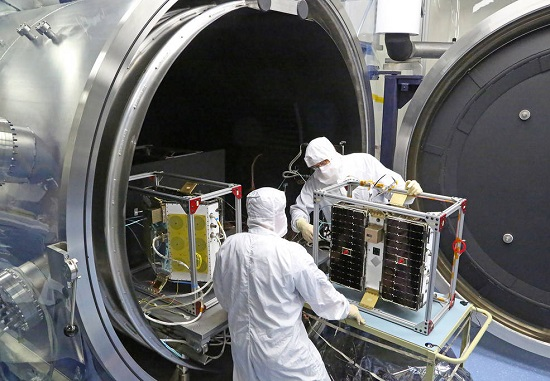 Thermal vacuum (shown) and other environmental tests of the CYGNSS microsatellites wrapped last month at the Southwest Research Institute in San Antonio, Texas. The final series of tests will soon commence on all eight observatories, stacked in the final launch configuration. (Credit: Southwest Research Institute)