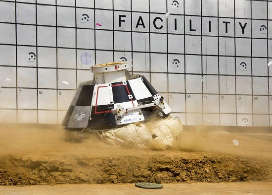 Dirt flies out as the mock-up of a Boeing CST-100 Starliner lands as part of testing on the spacecraft's landing system including airbags designed to absorb the shock of impact. (Credit: NASA/Langley Research Center)