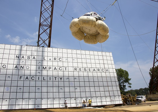 A Starliner mock-up is hoisted about 30 feet above the ground inside a gantry at NASA's Langley Research Center in Virginia before being released as part of testing on the spacecraft's landing systems. (Credit: NASA/Langley Research Center)