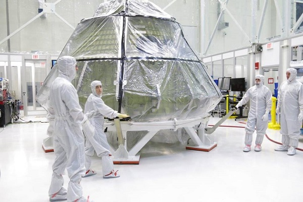 The Orion crew module for Exploration Mission 1 was transferred into the clean room inside the Neil Armstrong Operations and Checkout Building at Kennedy Space Center in late July to begin installation of the spacecraft's critical systems, including propellant lines. (Credit: NASA)