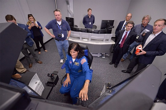 NASA Commercial Crew Program astronaut Sunita Williams demonstrates Boeing's Crew Part-Task Trainer, which is being used to prepare crew members to fly to the International Space Station aboard Boeing's CST-100 Starliner Spacecraft. (Credit: NASA/Lauren Harnett)