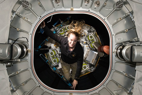 Kate Rubins inspects BEAM. (Credit: NASA)