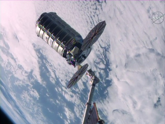 The Orbital ATK Cygnus space freighter is seen moments after being released from the grips of the Canadarm2 robotic arm. (Credit: NASA TV)