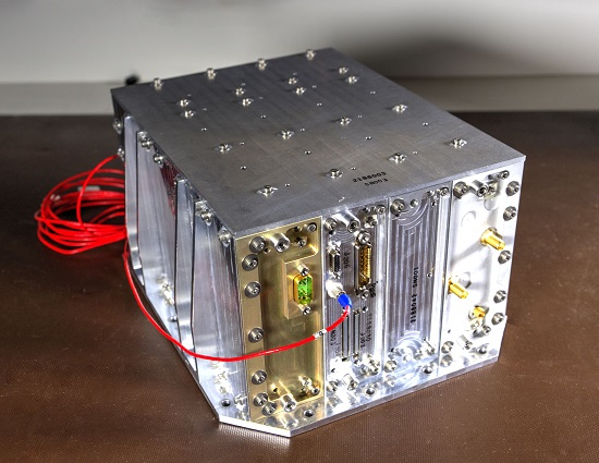 NavCube, the product of a merger between the Goddard-developed SpaceCube 2.0 and Navigator GPS technologies, could play a vital NavCube, the product of a merger between the Goddard-developed SpaceCube 2.0 and Navigator GPS technologies, could play a vital role helping to demonstrate X-ray communications in space — a potential NASA first. (Credit: NASA/W. Hrybyk)