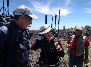 PISCES' John Hamilton (r) in the field at Craters of the Moon National Monument, Idaho, with two simulation astronauts. (Credit: PISCES)