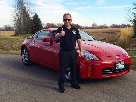Alan Stern with his Nissan. (Credit: Lowell Observatory)