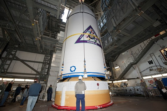 The U.S. Air Force's eighth Wideband Global SATCOM (WGS) satellite, encapsulated in a 5-meter payload fairing, is mated to a Delta IV booster at Cape Canaveral Air Force Station's Space Launch Complex (SLC)-37. (Credit: ULA)